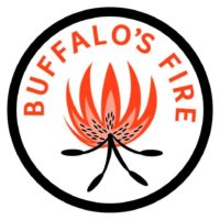 "Buffalo's fire logo. White circle with black border. An image of a red and orange wood fire graphic in the center of the circle. The text ""Buffalo's fire"" in red, capital letters above the fire."