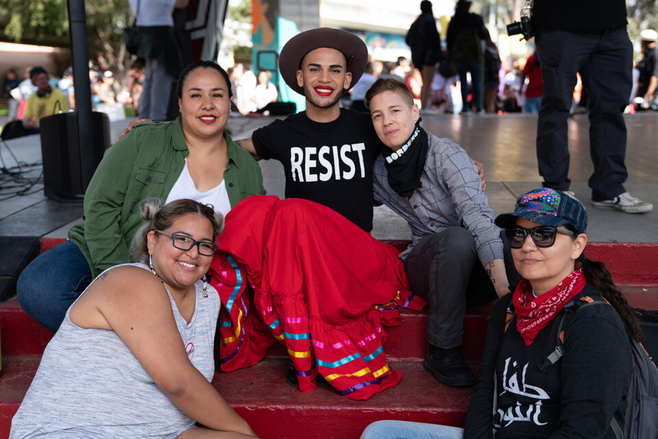 People gather in Chicano Park for the Free Our Future San Diego Action organized by Mijente and attended by a national coalition of supporters in San Diego, California on July 2, 2018. #AbolishICE #shutdownsessions #freeourfuture Las personas se reúnen en el Parque Chicano para la demostración Free Our Future, organizada por Mijente y asistida por una coalición nacional de simpatizantes en San Diego, California, el 2 de julio de 2018. Pictured at center: Alejandro Castelar of Tucson, Arizona, with the Mariposas Sin Fronteras group. Pictured with other Tucson-based activists. Photo by Angela Jimenez for Auburn Theological Seminary/Mijente